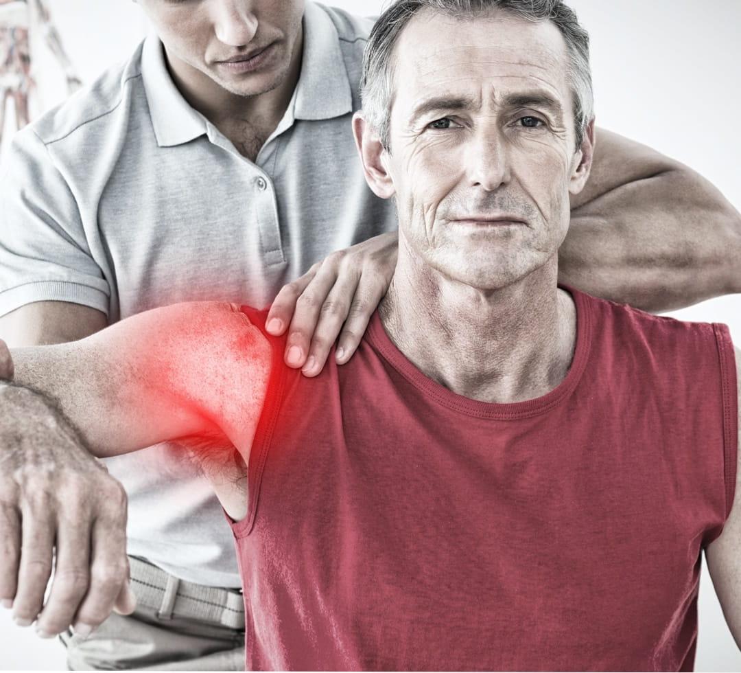 healthy elderly man getting shoulder treatment