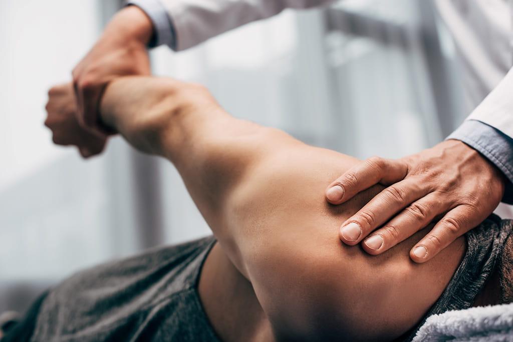 man shoulder treatment physio